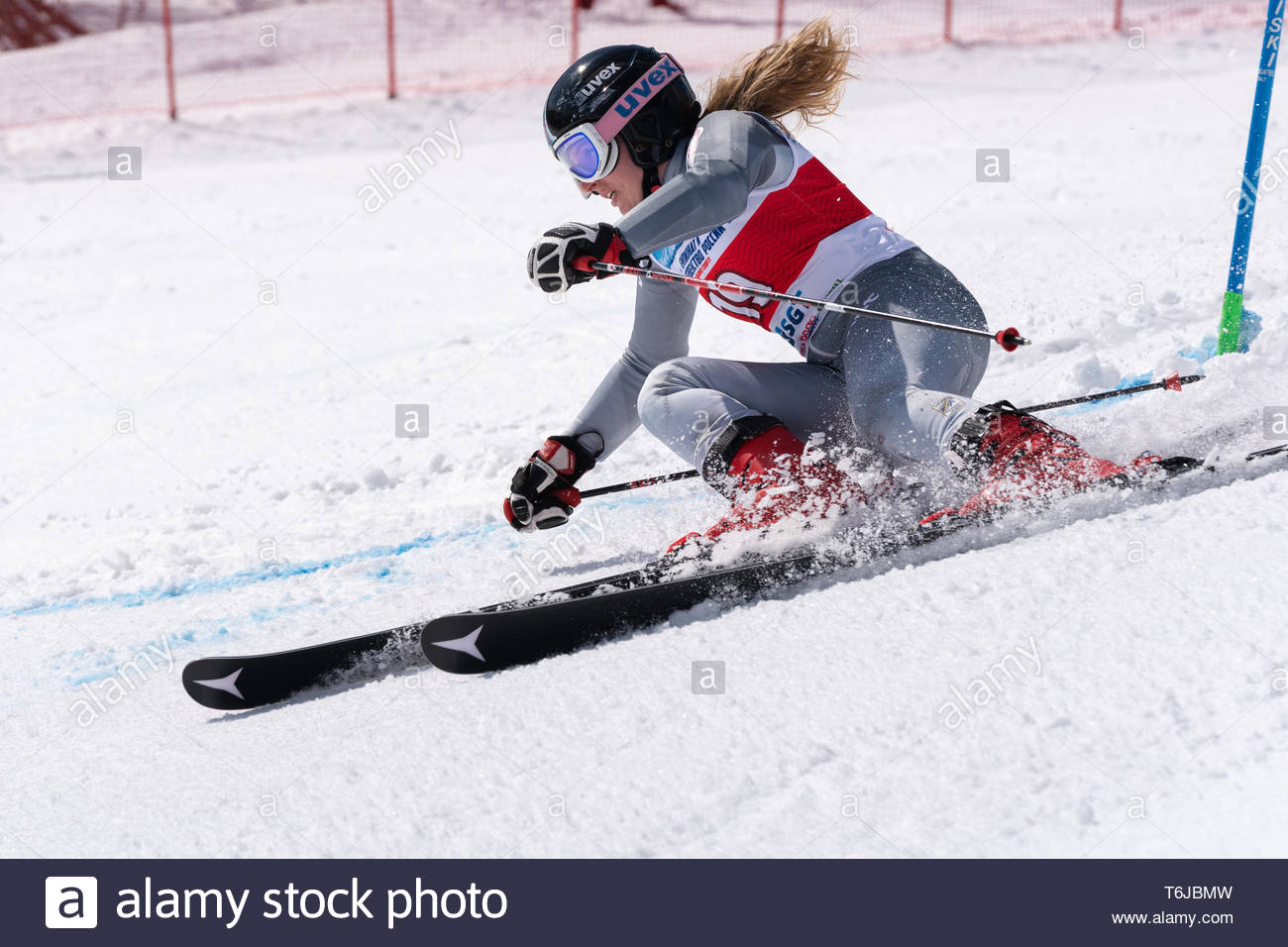 KAMCHATKA PENINSULA, RUSSIAN FEDERATION - APRIL 1, 2019: Mountain skier Milena Fokina (Kamchatka Peninsula) skiing down snowy mountain slope. Russian  - Stock Image