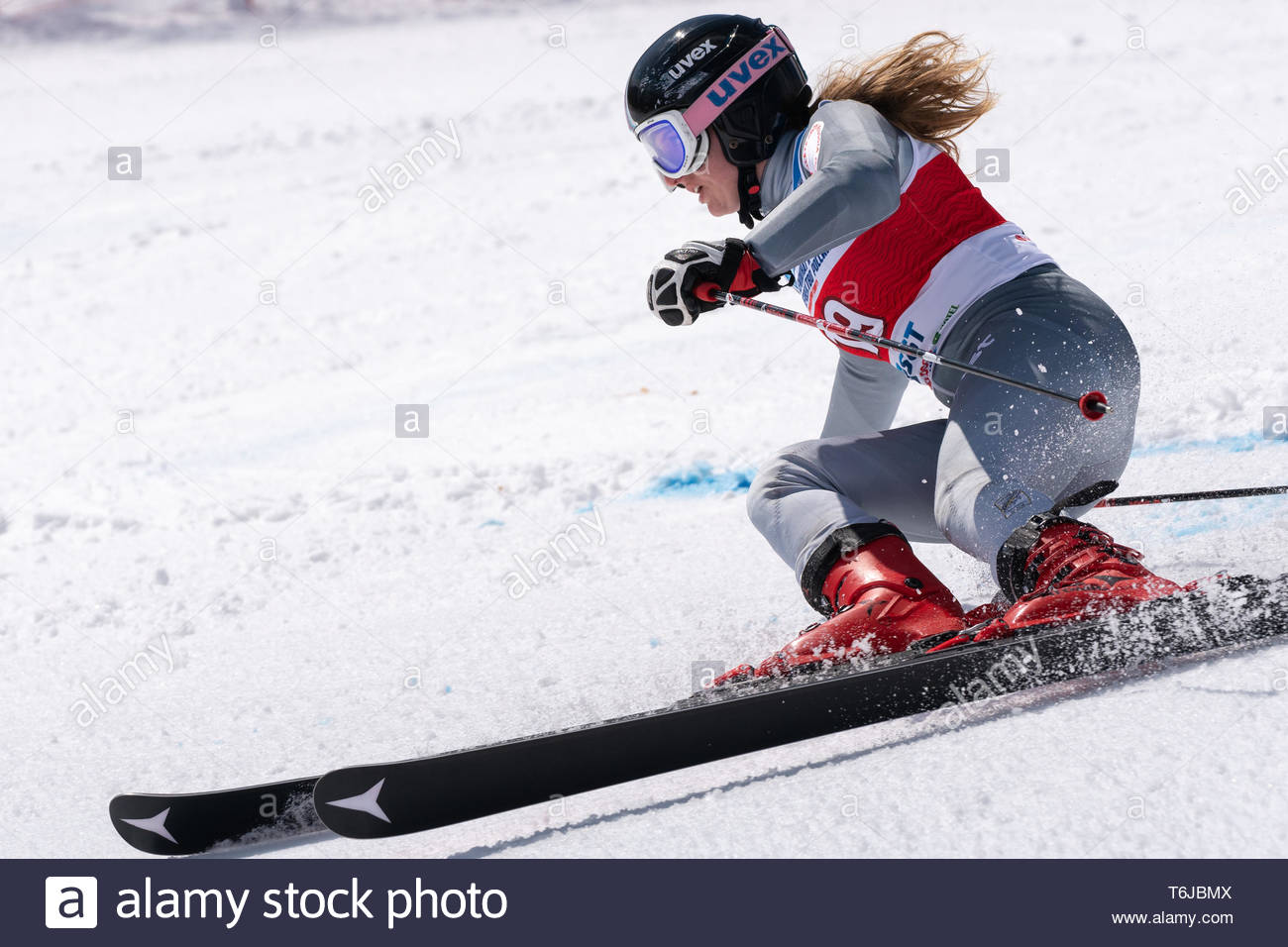 KAMCHATKA PENINSULA, RUSSIAN FEDERATION - APRIL 1, 2019: Russian Women's Alpine Skiing Championship, giant slalom. Mountain skier Fokina Milena (Kamch - Stock Image