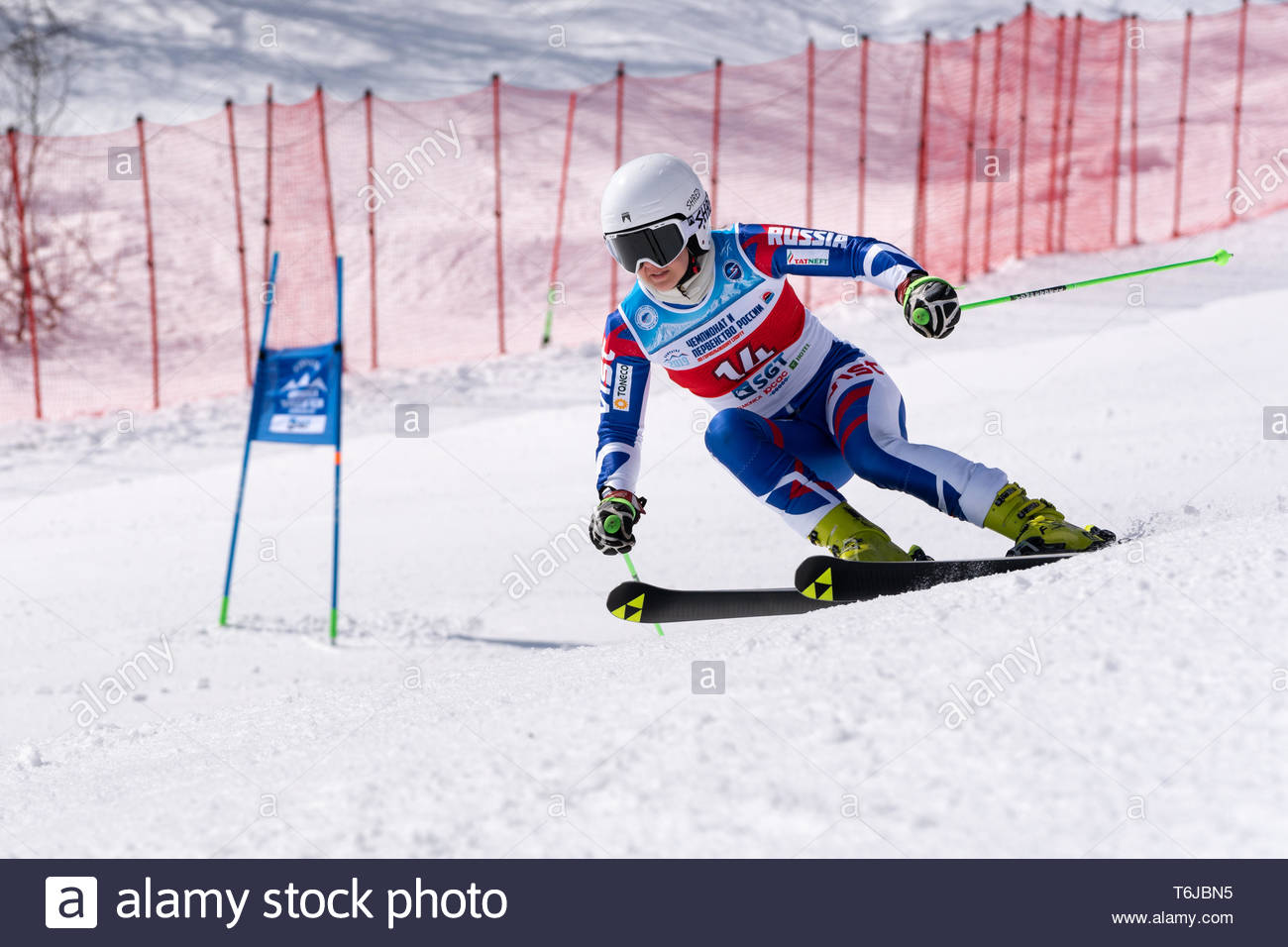 KAMCHATKA PENINSULA, RUSSIAN FEDERATION - APRIL 1, 2019: Mountain skier Shustrova Darya (St. Petersburg) skiing down snowy mountain slope. Russian Wom - Stock Image