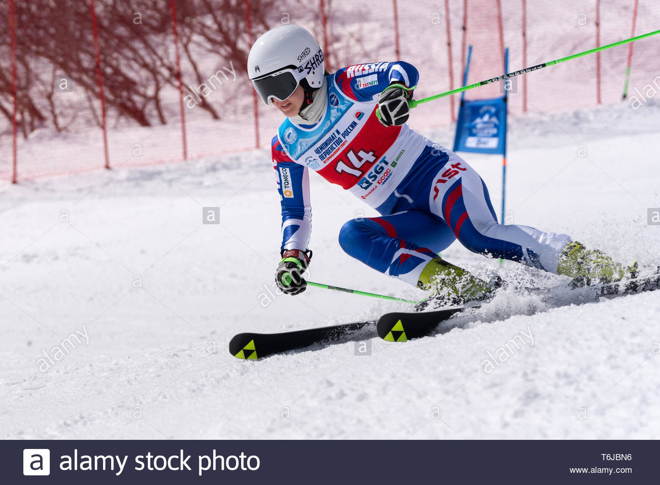 KAMCHATKA PENINSULA, RUSSIAN FEDERATION - APRIL 1, 2019: Russian Women's Alpine Skiing Championship, giant slalom. Mountain skier Shustrova Darya (St. - Stock Image
