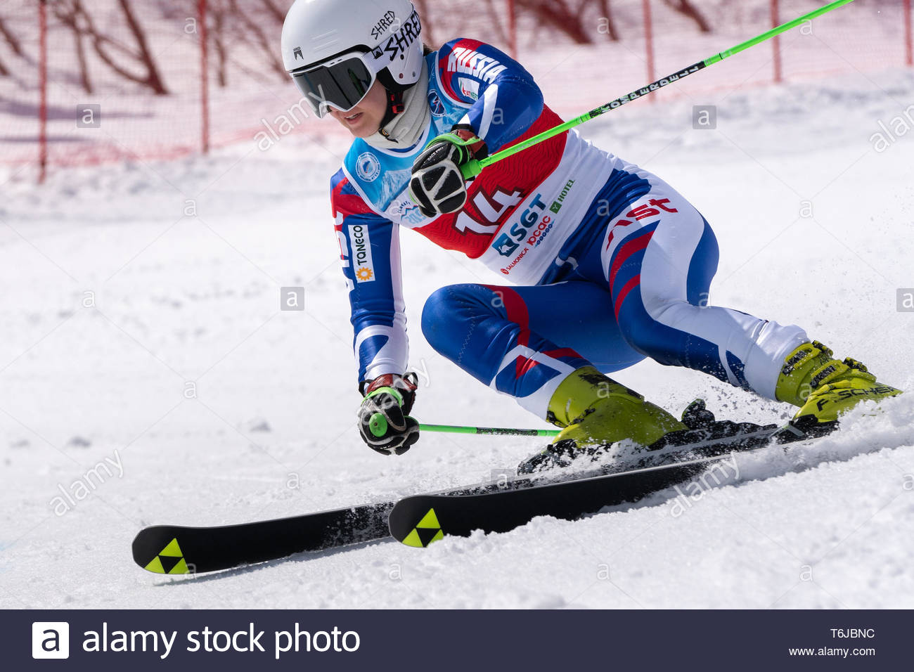 KAMCHATKA PENINSULA, RUSSIAN FEDERATION - APRIL 1, 2019: Mountain skier Darya Shustrova (St. Petersburg) skiing down snowy mountain slope. Russian Wom - Stock Image