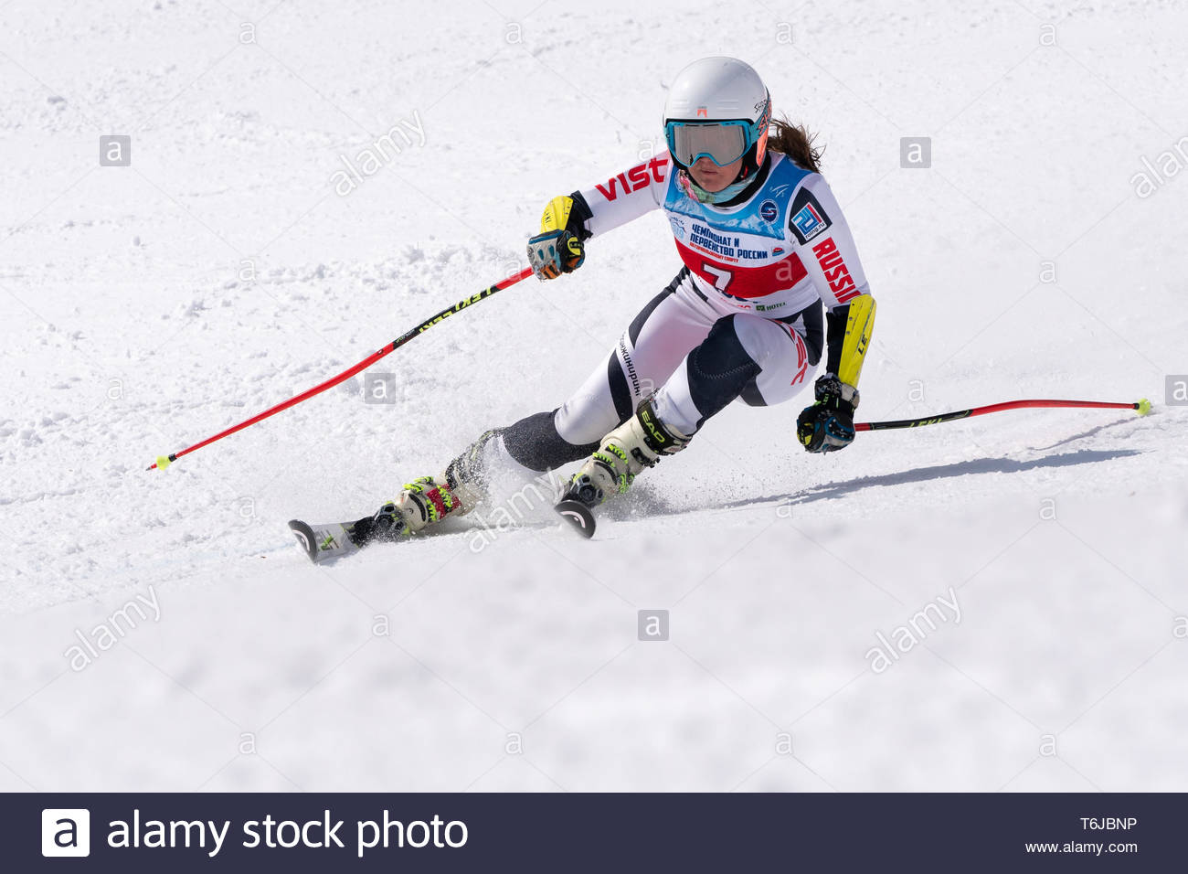 KAMCHATKA PENINSULA, RUSSIAN FEDERATION - APRIL 1, 2019: Russian Women's Alpine Skiing Championship, giant slalom. Mountain skier Popova Ekaterina (Ka - Stock Image