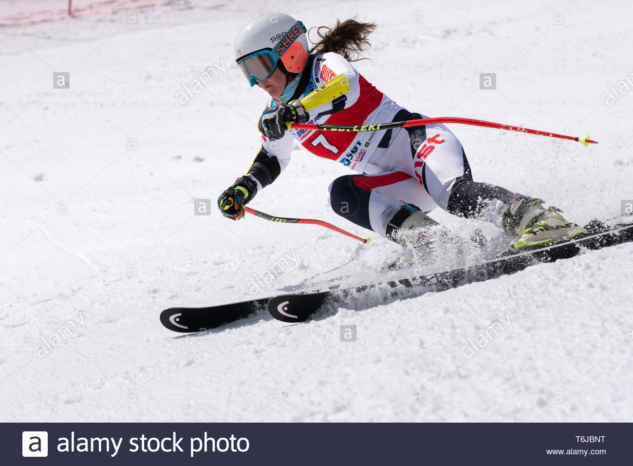 KAMCHATKA PENINSULA, RUSSIAN FEDERATION - APR 1, 2019: Mountain skier Popova Ekaterina (Kamchatka Peninsula) skiing down snowy mountain slope. Russian - Stock Image
