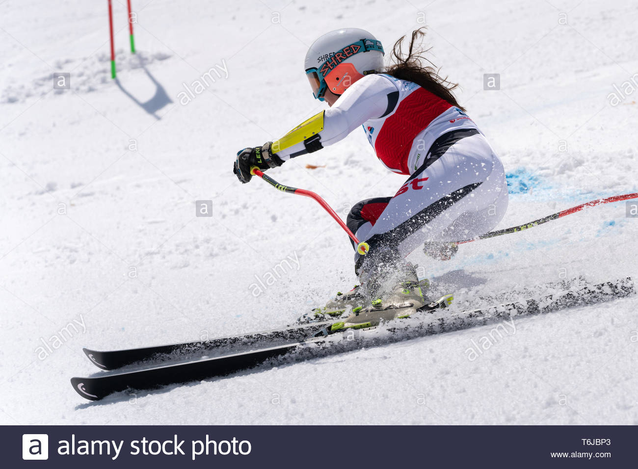 KAMCHATKA PENINSULA, RUSSIAN FEDERATION - APR 1, 2019: Mountain skier Ekaterina Popova (Kamchatka Peninsula) skiing down snowy mountain slope. Russian - Stock Image