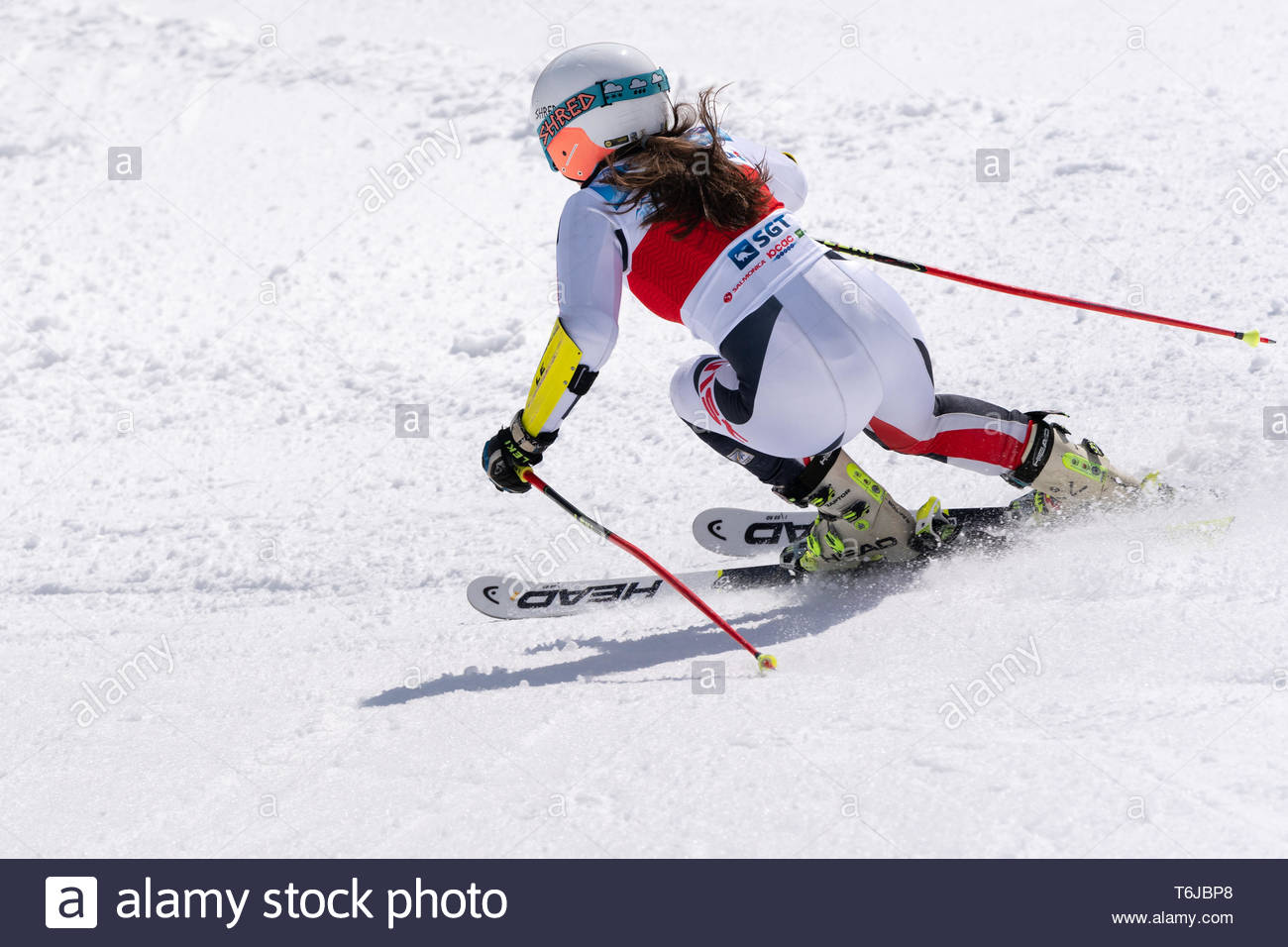 KAMCHATKA PENINSULA, RUSSIAN FEDERATION - APR 1, 2019: Russian Women's Alpine Skiing Championship, giant slalom. Mountain skier Popova Ekaterina (Kamc - Stock Image