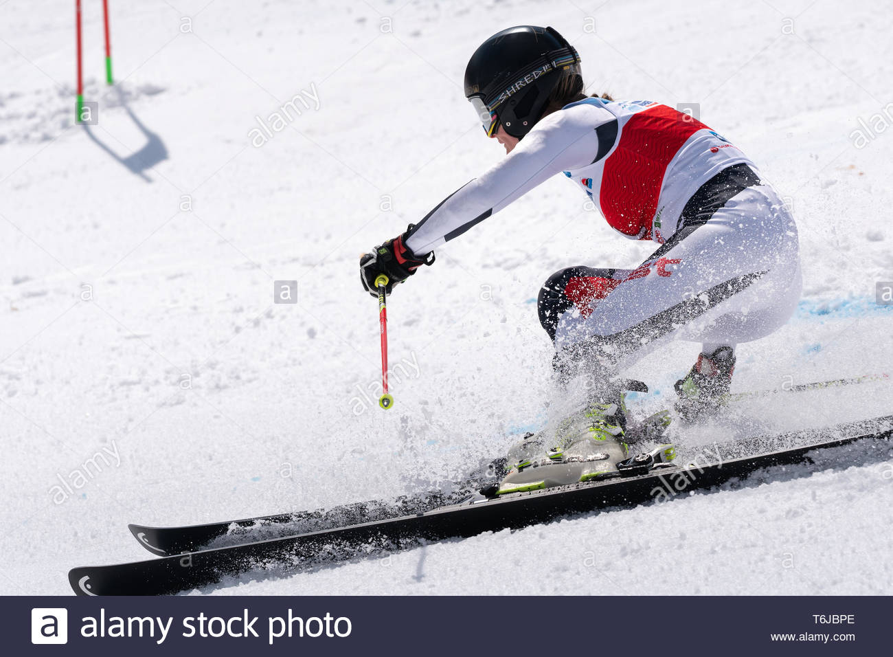 KAMCHATKA PENINSULA, RUSSIAN FEDERATION - APRIL 1, 2019: Mountain skier Golenkova Valentina (Moscow Region) skiing down snowy mountain slope. Russian  - Stock Image