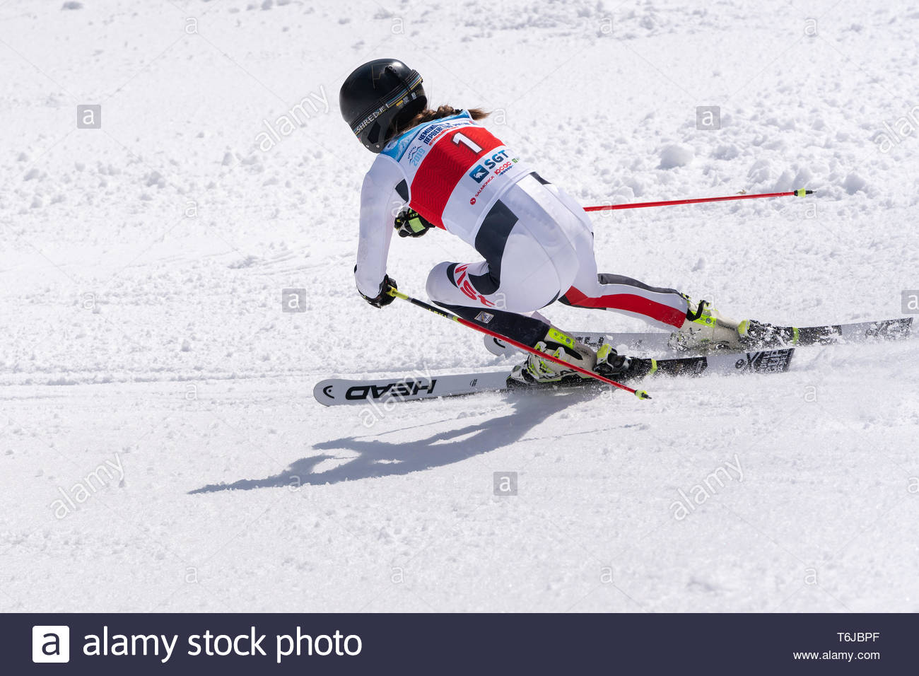 KAMCHATKA PENINSULA, RUSSIAN FEDERATION - APRIL 1, 2019: Russian Women's Alpine Skiing Championship, giant slalom. Mountain skier Valentina Golenkova  - Stock Image