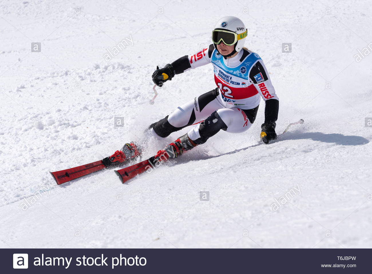 KAMCHATKA PENINSULA, RUSSIAN FEDERATION - APR 1, 2019: Russian Women's Alpine Skiing Championship, giant slalom. Mountain skier Darya Kolomova (Krasno - Stock Image