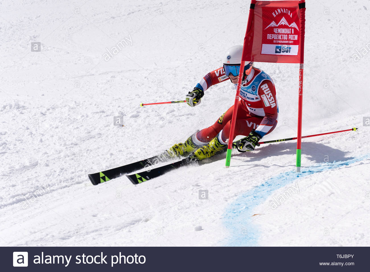 KAMCHATKA PENINSULA, RUSSIAN FEDERATION - APRIL 1, 2019: Mountain skier Abdulkayumova Rinata (Kamchatka) skiing down snowy mountain slope. Russian Wom - Stock Image