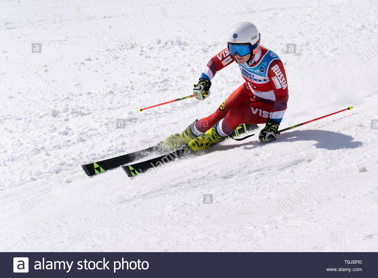 KAMCHATKA PENINSULA, RUSSIAN FEDERATION - APR 1, 2019: Russian Women's Alpine Skiing Championship, giant slalom. Mountain skier Rinata Abdulkayumova ( - Stock Image