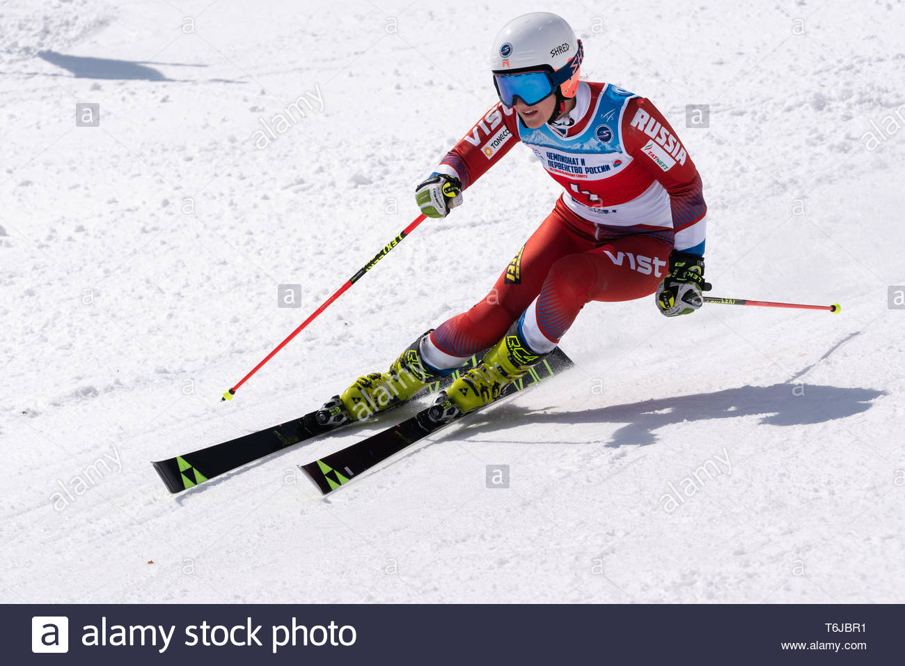 KAMCHATKA PENINSULA, RUSSIAN FEDERATION - APRIL 1, 2019: Mountain skier Rinata Abdulkayumova (Kamchatka) skiing down snowy mountain slope. Russian Wom - Stock Image