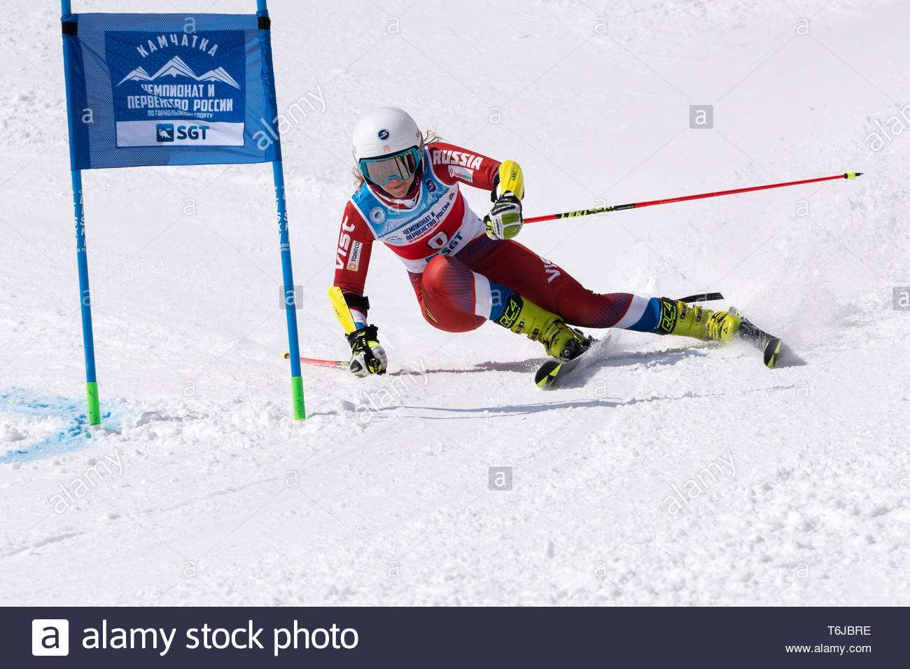 KAMCHATKA PENINSULA, RUSSIAN FEDERATION - APRIL 1, 2019: Mountain skier Krokhina Sofya (Moscow) skiing down snowy mountain slope. Russian Women's Alpi - Stock Image