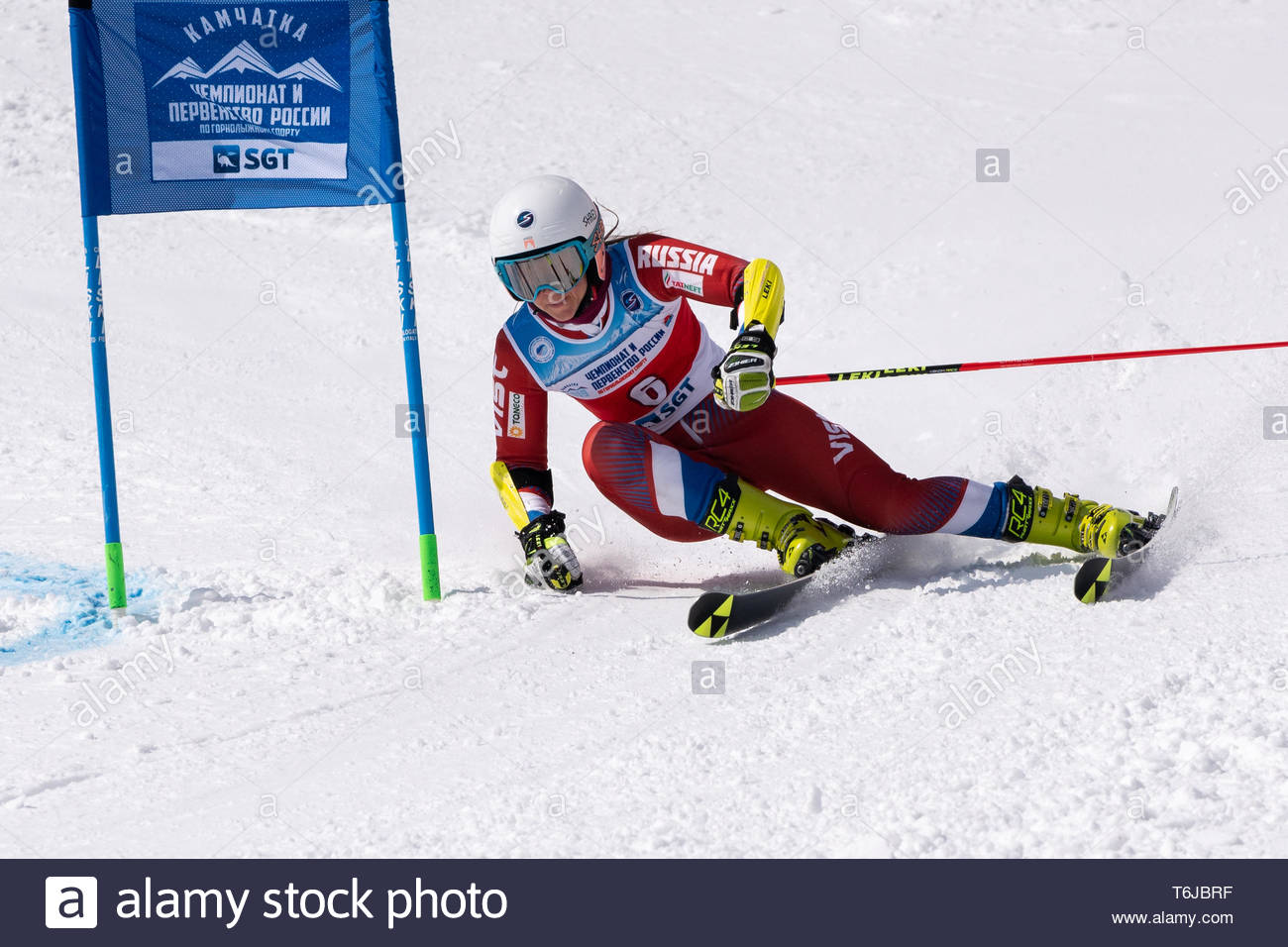KAMCHATKA PENINSULA, RUSSIAN FEDERATION - APRIL 1, 2019: Russian Women's Alpine Skiing Championship, giant slalom. Mountain skier Sofya Krokhina (Mosc - Stock Image