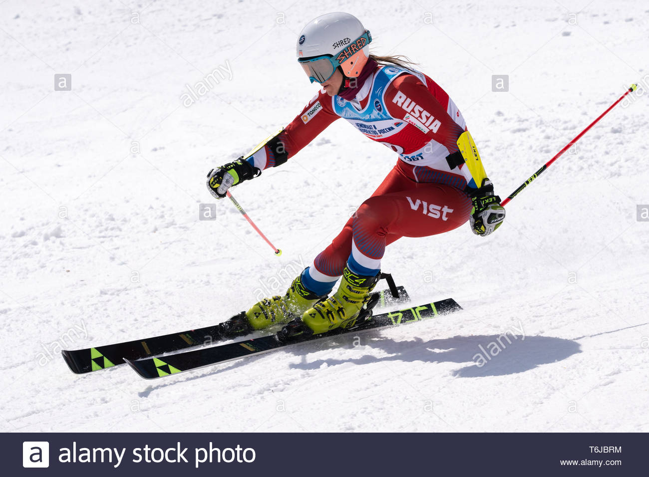 KAMCHATKA PENINSULA, RUSSIAN FEDERATION - APRIL 1, 2019: Mountain skier Sofya Krokhina (Moscow) skiing down snowy mountain slope. Russian Women's Alpi - Stock Image