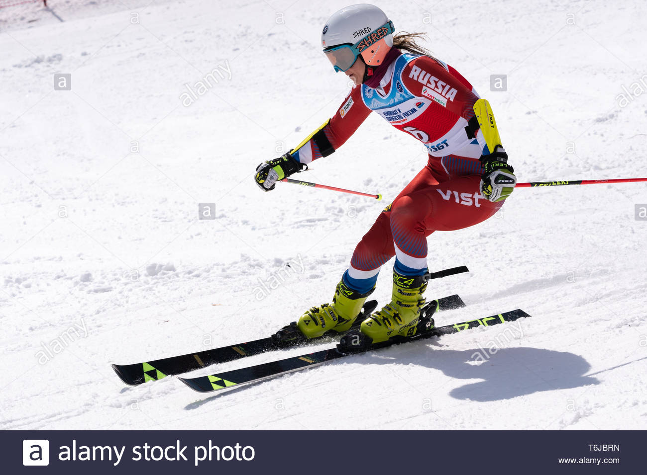 KAMCHATKA PENINSULA, RUSSIAN FEDERATION - APRIL 1, 2019: Russian Women's Alpine Skiing Championship, giant slalom. Mountain skier Krokhina Sofya (Mosc - Stock Image