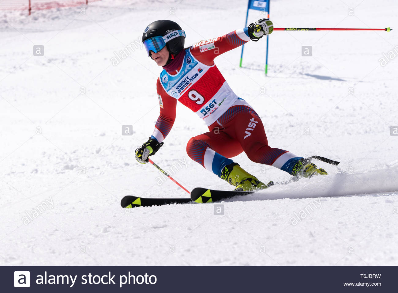 KAMCHATKA PENINSULA, RUSSIAN FEDERATION - APRIL 1, 2019: Mountain skier Melnikova Polina (Moscow) skiing down snowy mountain slope. Russian Women's Al - Stock Image
