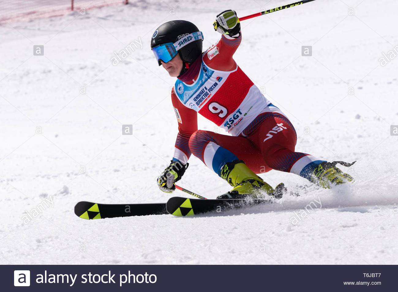 KAMCHATKA PENINSULA, RUSSIAN FEDERATION - APRIL 1, 2019: Russian Women's Alpine Skiing Championship, giant slalom. Mountain skier Polina Melnikova (Mo - Stock Image