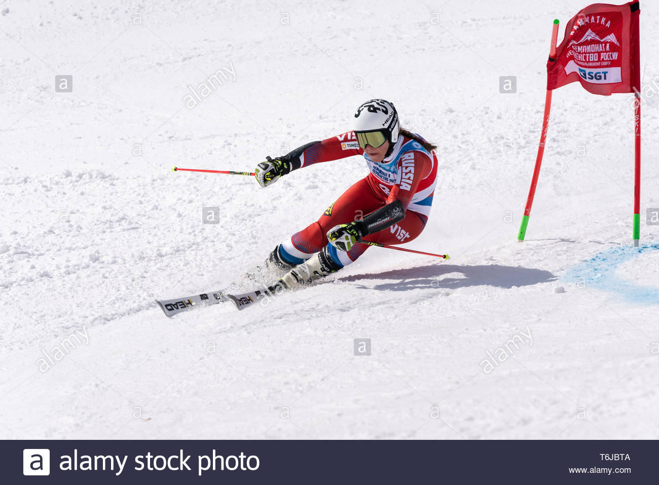 KAMCHATKA PENINSULA, RUSSIAN FEDERATION - APRIL 1, 2019: Russian Women's Alpine Skiing Championship, giant slalom. Mountain skier Pleshkova Julia (Kam - Stock Image