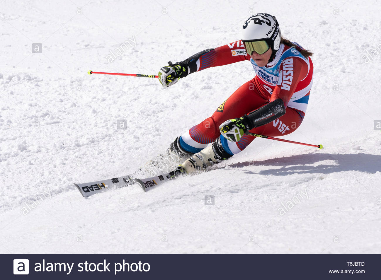 KAMCHATKA PENINSULA, RUSSIAN FEDERATION - APRIL 1, 2019: Mountain skier Julia Pleshkova (Kamchatka Region) skiing down snowy mountain slope. Russian W - Stock Image