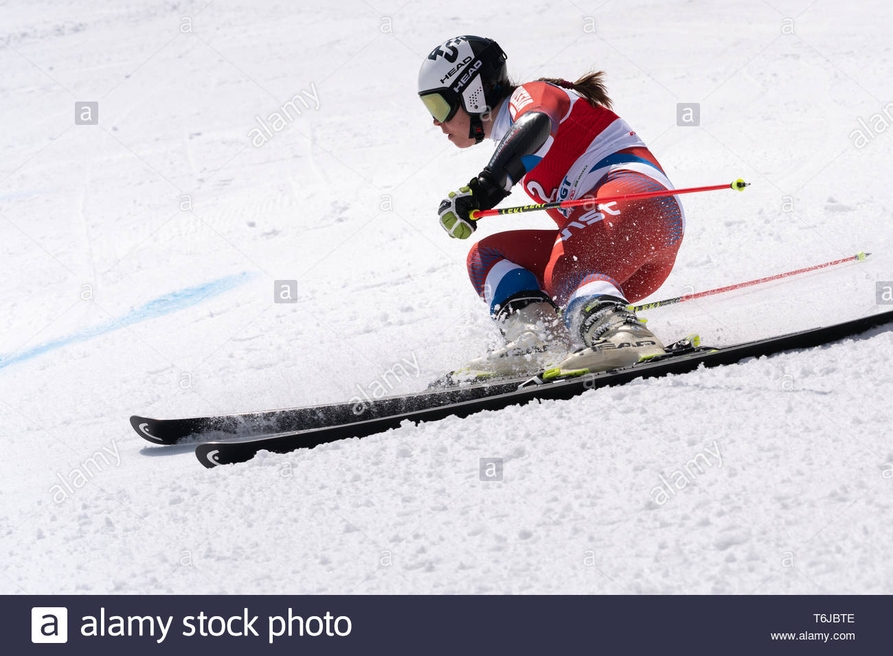 KAMCHATKA PENINSULA, RUSSIAN FEDERATION - APRIL 1, 2019: Mountain skier Pleshkova Julia (Kamchatka Peninsula) skiing down snowy mountain slope. Russia - Stock Image