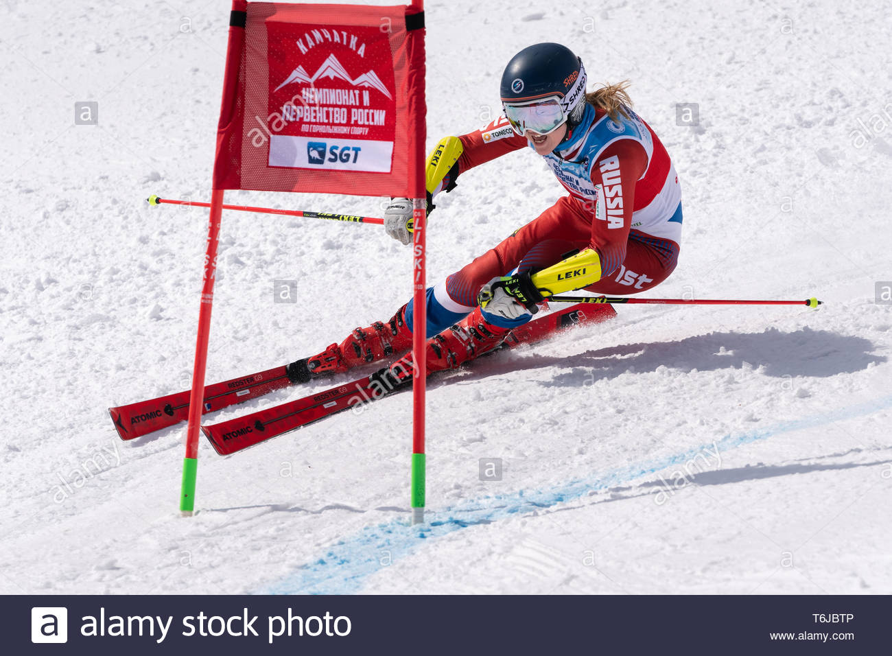 KAMCHATKA PENINSULA, RUSSIAN FEDERATION - APRIL 1, 2019: Mountain skier Tkachenko Ekaterina (Moscow) skiing down snowy mountain slope. Russian Women's - Stock Image