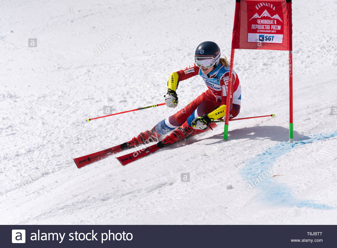 KAMCHATKA PENINSULA, RUSSIAN FEDERATION - APRIL 1, 2019: Russian Women's Alpine Skiing Championship, giant slalom. Mountain skier Ekaterina Tkachenko  - Stock Image