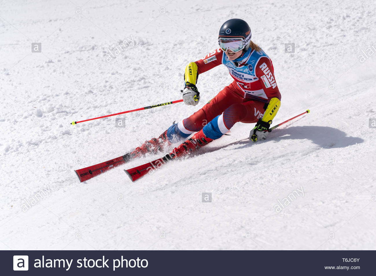 KAMCHATKA PENINSULA, RUSSIAN FEDERATION - APRIL 1, 2019: Mountain skier Ekaterina Tkachenko (Moscow) skiing down snowy mountain slope. Russian Women's - Stock Image