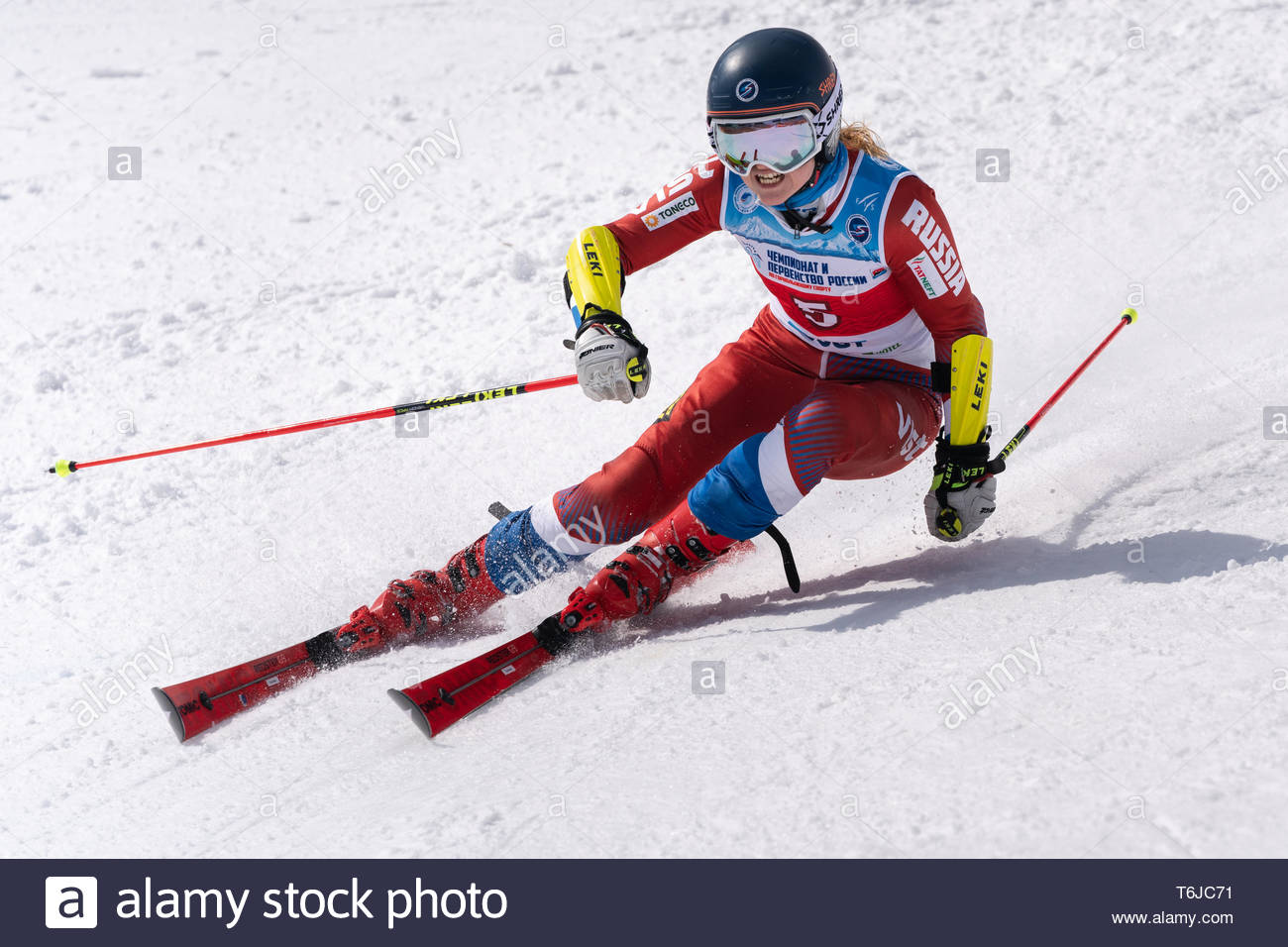 KAMCHATKA PENINSULA, RUSSIAN FEDERATION - APRIL 1, 2019: Russian Women's Alpine Skiing Championship, giant slalom. Mountain skier Tkachenko Ekaterina  - Stock Image