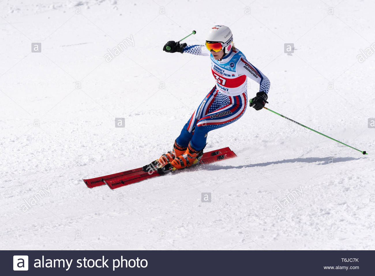 KAMCHATKA PENINSULA, RUSSIA - APRIL 1, 2019: Mountain skier Perfilova Ekaterina (Krasnoyarsk Territory) skiing down snowy mountain slope. Russian Wome - Stock Image