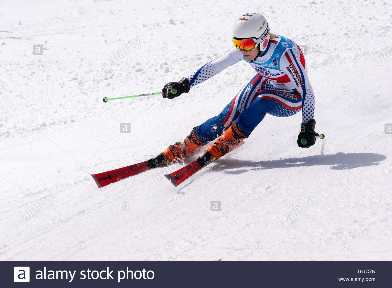 KAMCHATKA PENINSULA, RUSSIAN FEDERATION - APR 1, 2019: Russian Women's Alpine Skiing Championship giant slalom. Mountain skier Ekaterina Perfilova (Kr - Stock Image