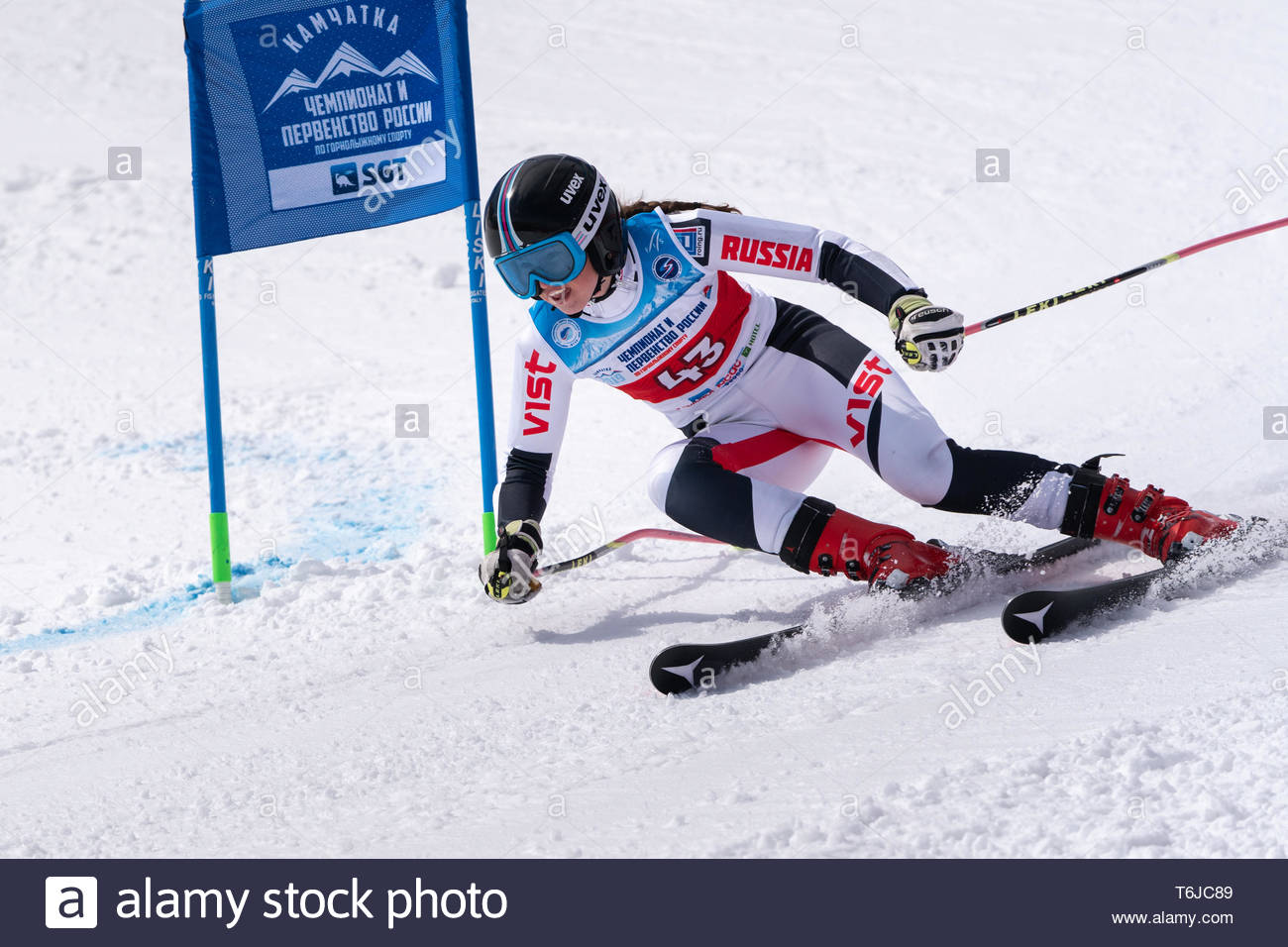 KAMCHATKA PENINSULA, RUSSIAN FEDERATION - APRIL 1, 2019: Mountain skier Dyachenko Ellina (Sakhalin Region) skiing down snowy mountain slope. Russian W - Stock Image
