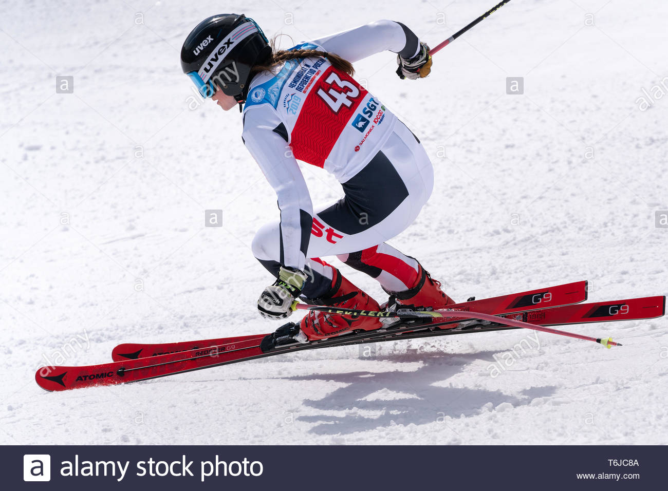 KAMCHATKA PENINSULA, RUSSIAN FEDERATION - APRIL 1, 2019: Russian Women's Alpine Skiing Championship giant slalom. Mountain skier Ellina Dyachenko (Sak - Stock Image