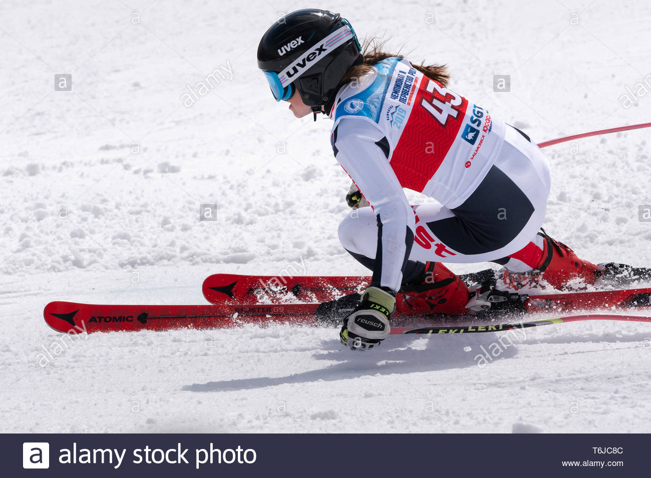 KAMCHATKA PENINSULA, RUSSIAN FEDERATION - APRIL 1, 2019: Russian Women's Alpine Skiing Championship giant slalom. Mountain skier Dyachenko Ellina (Sak - Stock Image