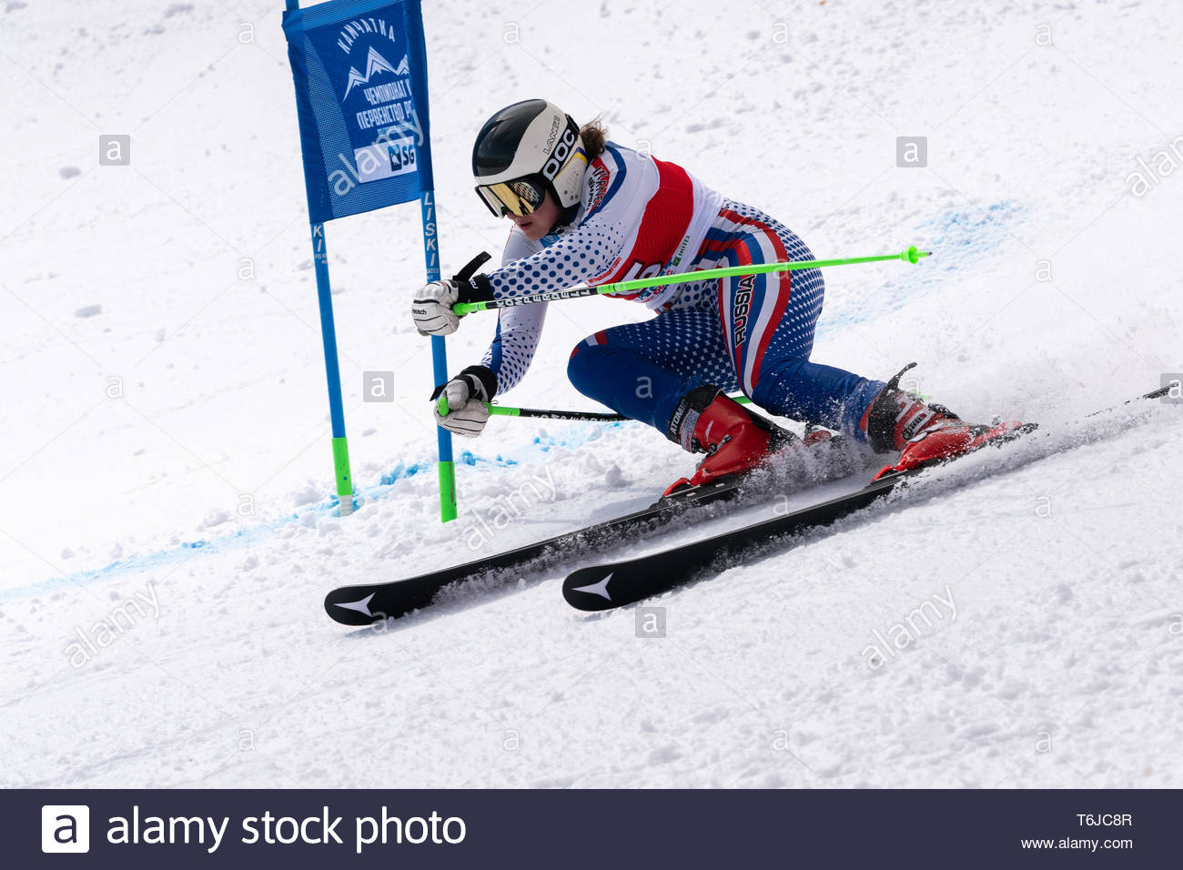 KAMCHATKA PENINSULA, RUSSIAN FEDERATION - APRIL 1, 2019: Mountain skier Khartsyzova Alena (St. Petersburg) skiing down snowy mountain slope. Russian W - Stock Image