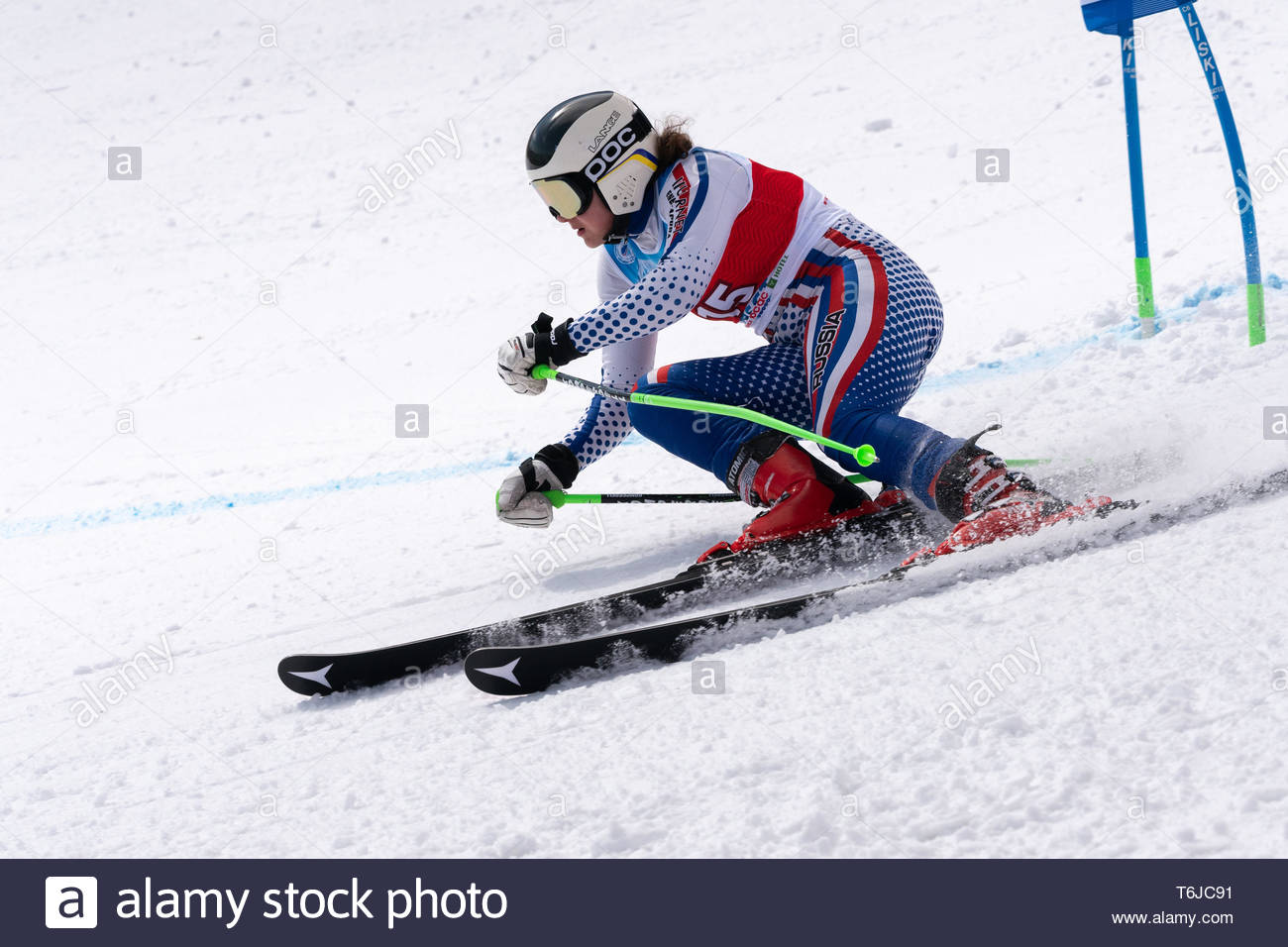KAMCHATKA PENINSULA, RUSSIAN FEDERATION - APRIL 1, 2019: Russian Women's Alpine Skiing Championship, giant slalom. Mountain skier Alena Khartsyzova (S - Stock Image