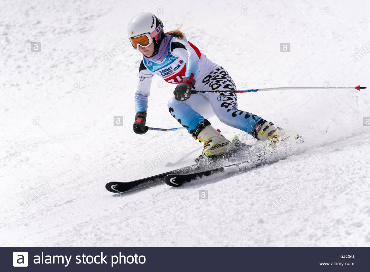 KAMCHATKA PENINSULA, RUSSIAN FEDERATION - APRIL 1, 2019: Mountain skier Kazakova Vitaliya (Murmansk Region) skiing down snowy mountain slope. Russian  - Stock Image