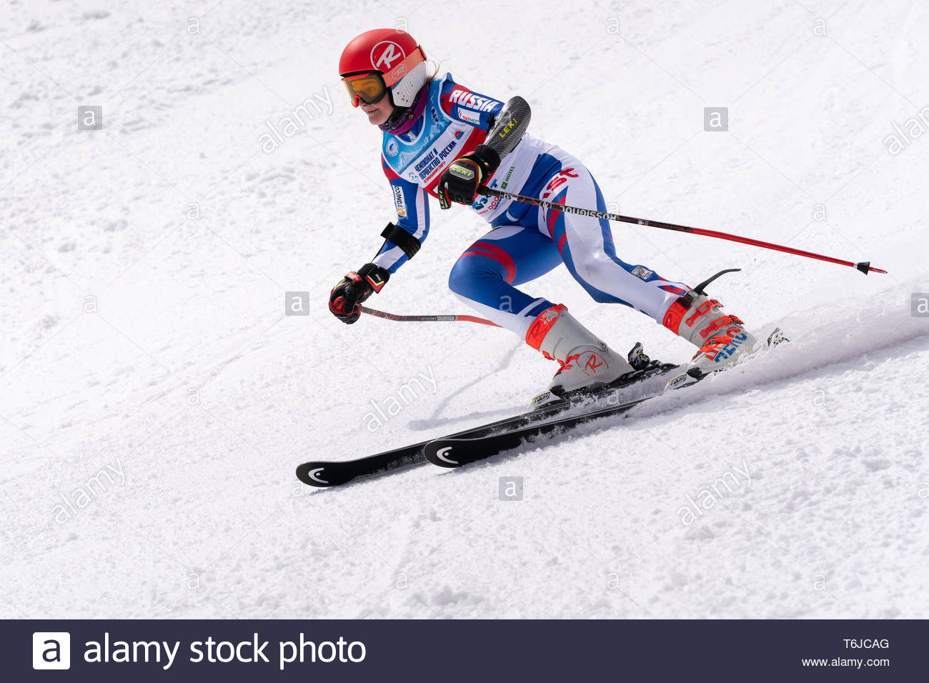 KAMCHATKA PENINSULA, RUSSIAN FEDERATION - APRIL 1, 2019: Mountain skier Arkhipova Sofya (Sverdlovsk Region) skiing down snowy mountain slope. Russian  - Stock Image
