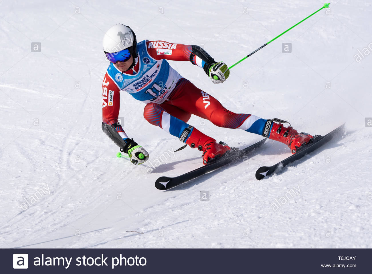 KAMCHATKA PENINSULA, RUSSIA - APR 1, 2019: Mountain skier Alekhin Nikita (Kamchatka) skiing down mount slope. Russian Alpine Skiing Cup, International - Stock Image
