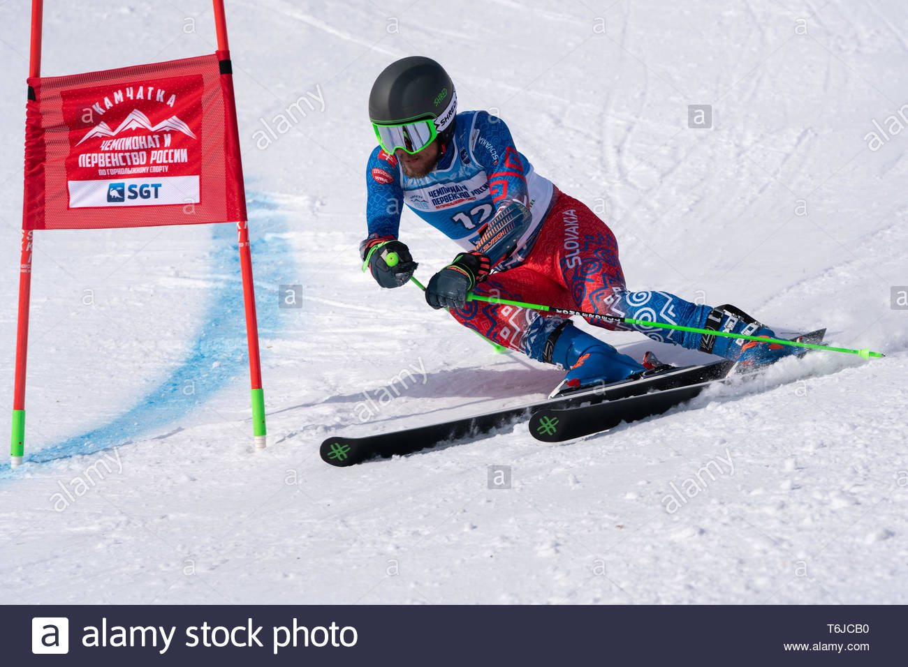 MOROZNAYA MOUNTAIN, KAMCHATKA PENINSULA, RUSSIAN FAR EAST - APR 1, 2019: Mountain skier Matej Falat (Slovakia) skiing down mountain slope. Internation - Stock Image