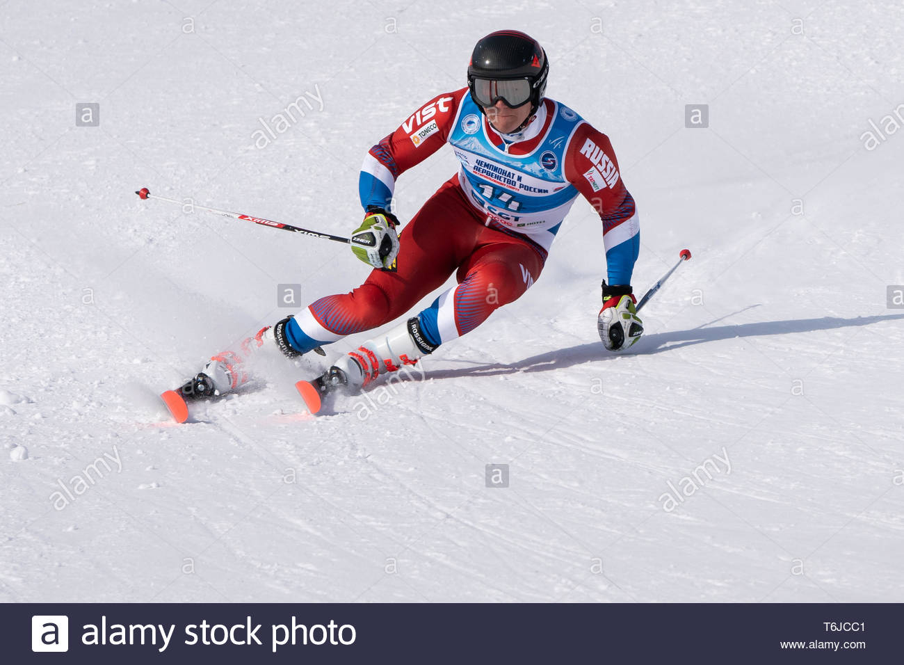 KAMCHATKA PENINSULA, RUSSIA - APR 1, 2019: Mountain skier Pavel Trihichev (Moscow) skiing down mount slope. Russian Alpine Skiing Cup, International S - Stock Image