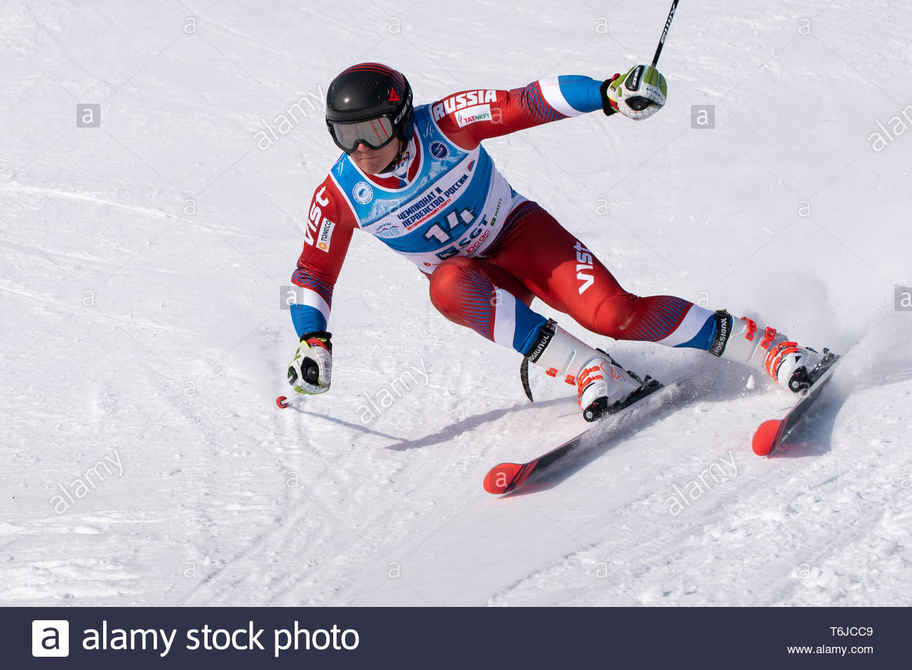 KAMCHATKA PENINSULA, RUSSIA - APR 1, 2019: Russian Alpine Skiing Cup, International Ski Federation (FIS) Championship - giant slalom. Mountain skier T - Stock Image