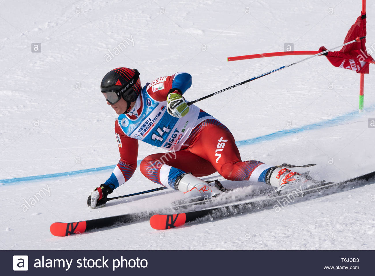 KAMCHATKA PENINSULA, RUSSIA - APR 1, 2019: Mountain skier Trihichev Pavel (Moscow) skiing down mount slope. Russian Alpine Skiing Cup, International S - Stock Image