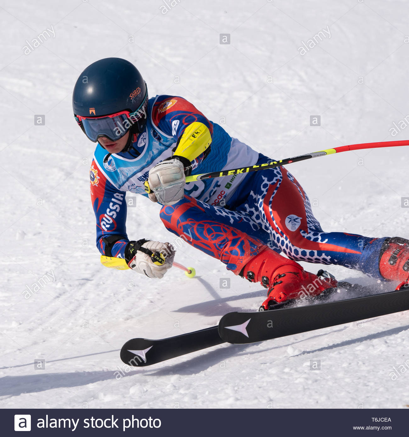 KAMCHATKA PENINSULA, RUSSIA - APR 1, 2019: Mountain skier Prikhodchenko Vadim (Moscow) skiing down mount slope. Russian Alpine Skiing Cup, Internation - Stock Image