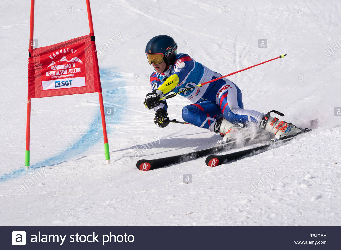 KAMCHATKA PENINSULA, RUSSIA - APR 1, 2019: Mountain skier Guryanov Nikita (Moscow) skiing down mount slope. Russian Alpine Skiing Cup, International S - Stock Image