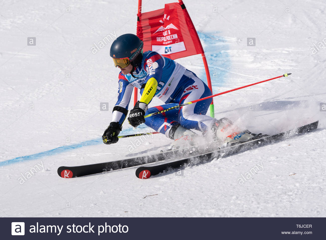 KAMCHATKA PENINSULA, RUSSIA - APR 1, 2019: Russian Alpine Skiing Cup, International Ski Federation (FIS) Championship - giant slalom. Mountain skier N - Stock Image