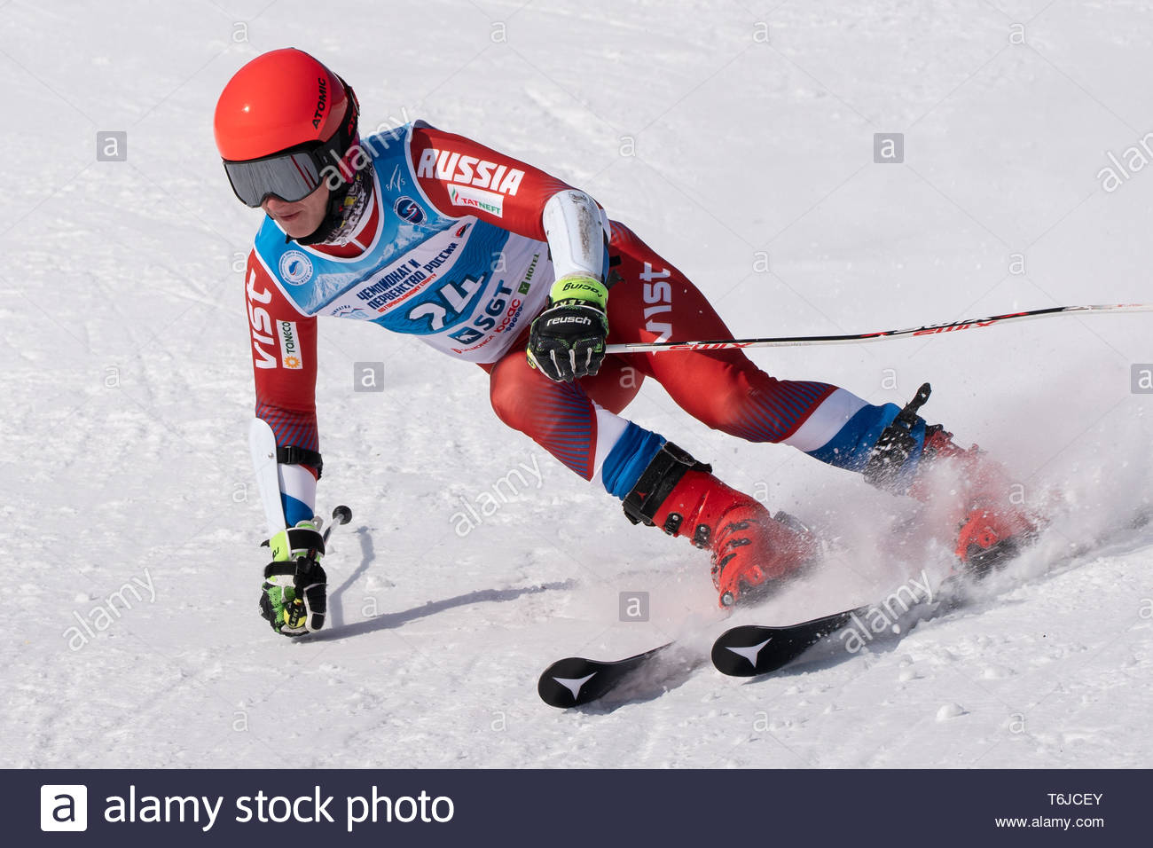 KAMCHATKA PENINSULA, RUSSIA - APR 1, 2019: Mountain skier Osipov Vladislav (Sakhalin) skiing down mount slope. Russian Alpine Skiing Cup, Internationa - Stock Image
