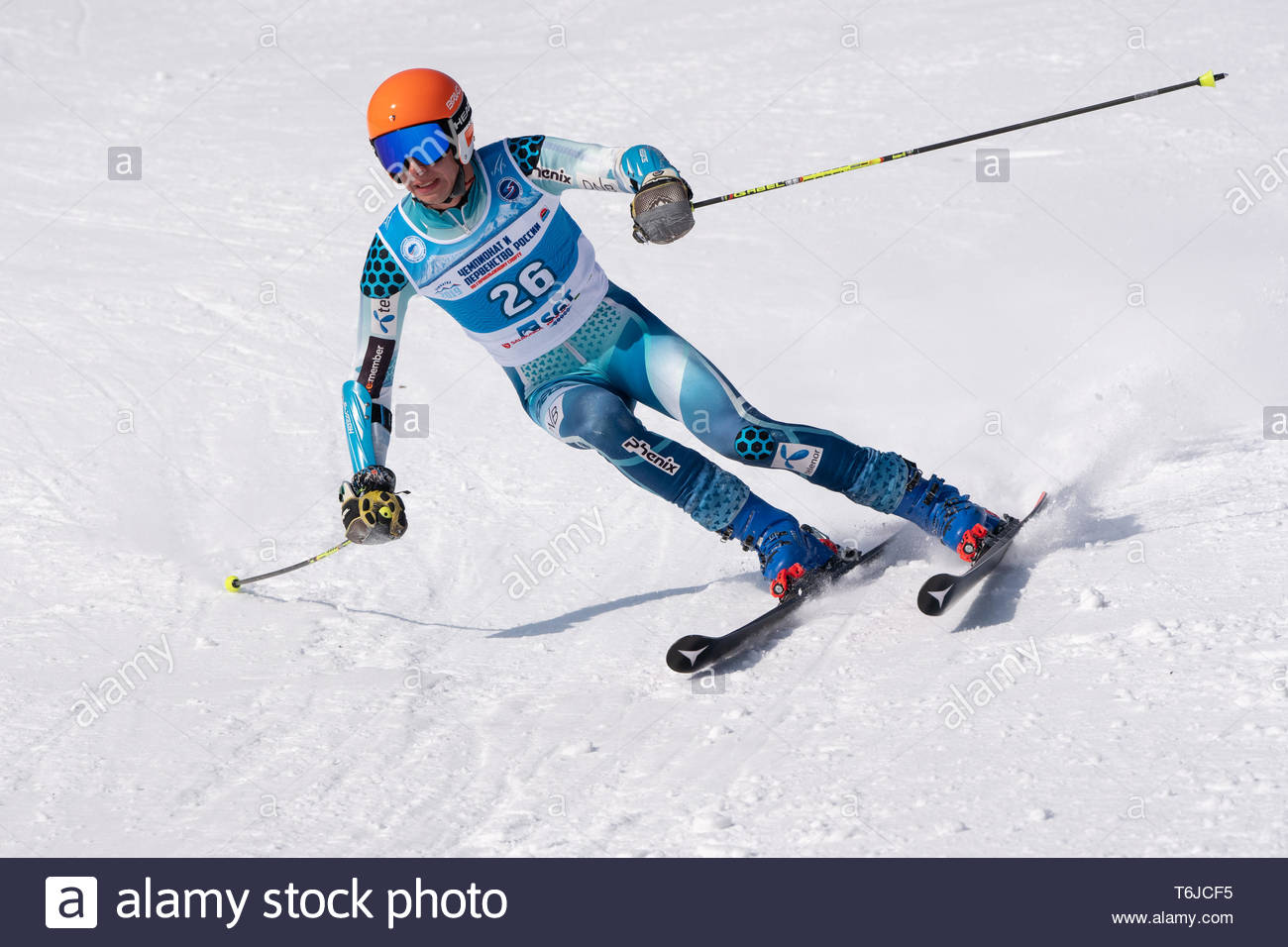 KAMCHATKA PENINSULA, RUSSIA - APR 1, 2019: Mountain skier Lomovskikh Matvey (St. Petersburg) skiing down slope. Russian Alpine Skiing Cup, Internation - Stock Image