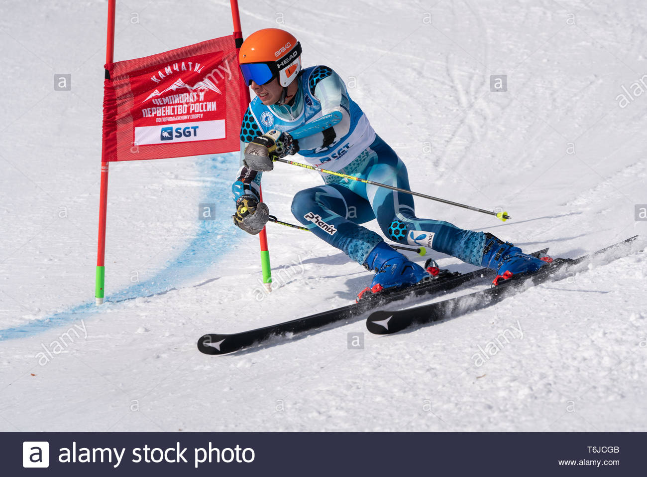 KAMCHATKA PENINSULA, RUSSIA - APR 1, 2019: Mountain skier Matvey Lomovskikh (St. Petersburg) skiing down slope. Russian Alpine Skiing Cup, Internation - Stock Image