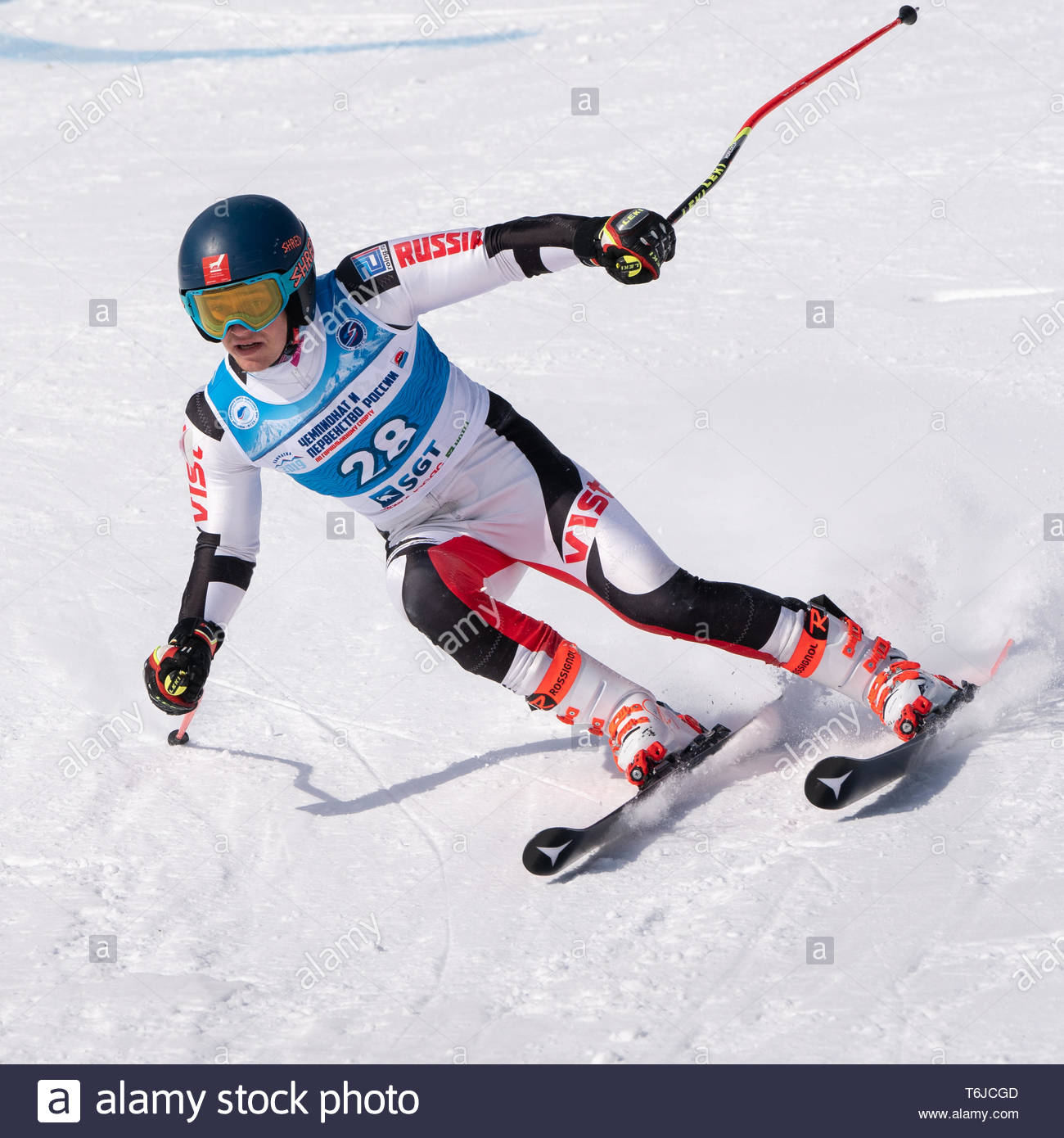 KAMCHATKA PENINSULA, RUSSIA - APR 1, 2019: Mountain skier Sazonov Egor (Kamchatka Krai) skiing down mount slope. Russian Alpine Skiing Cup, Internatio - Stock Image
