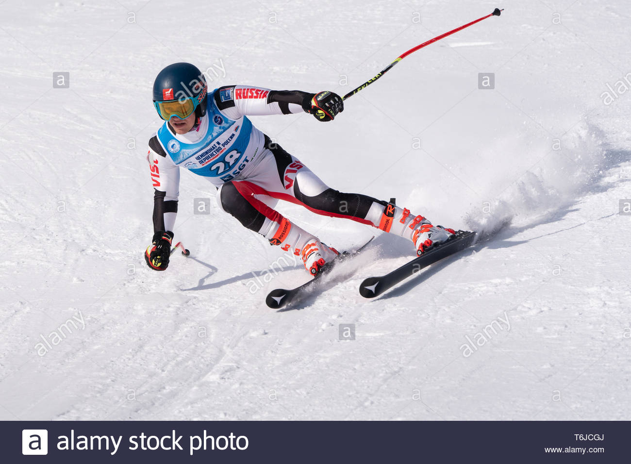 KAMCHATKA PENINSULA, RUSSIA - APR 1, 2019: Russian Alpine Skiing Cup, International Ski Federation (FIS) Championship, giant slalom. Mount skier Sazon - Stock Image